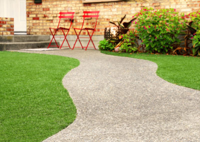 Way with perfect grass landscaping with artificial grass